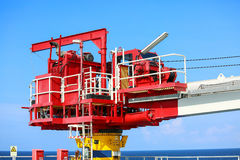 Crane construction on Oil and Rig platform for support heavy cargo, Transfer cargo or basket on work site, Heavy industry. Heavy job on the oil and gas Stock Photos