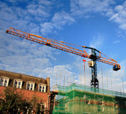 Crane on a Construction Site. View of a Construction Crane on a building site against an early morning blue sky Royalty Free Stock Photography