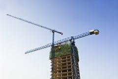 Big cranes work on a skyscraper Royalty Free Stock Photo