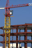 Crane on construction site Royalty Free Stock Images