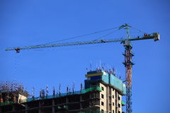 Crane at construction site Royalty Free Stock Photo