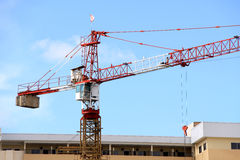 Crane on construction site. One of the major equipment or lifting device needed to speed up construction process Stock Photography