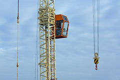 Crane on construction site Stock Images