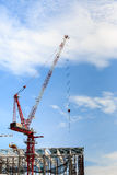 Crane at construction site against blue sky Stock Image