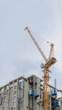 Crane and construction site. On blue sky background Stock Photos