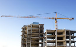 Crane construction site blue sky background Royalty Free Stock Images