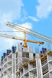 Crane and construction site Stock Images