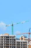 Crane and construction site Stock Photography