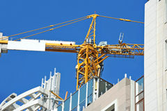 Crane and construction site Stock Photo