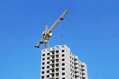Crane and construction site Stock Photos