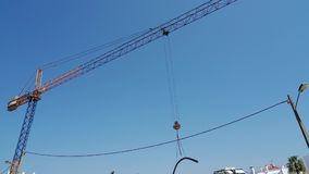 A crane on a construction site carries material. In Portugal. stock video