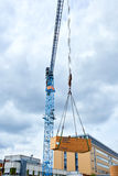 Crane on construction site. Crane hook on construction site Royalty Free Stock Photography