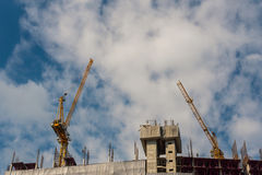 Crane in construction site Royalty Free Stock Photo