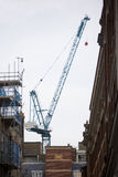 Crane at construction site in London. Royalty Free Stock Images