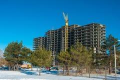Crane on a construction site Stock Photos