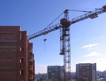 Crane at the construction site near the object works royalty free stock photo