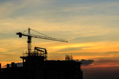 Crane in construction site Stock Images
