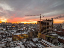 Crane in the construction site under the sunset Royalty Free Stock Image