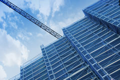 A crane in a construction work. Tall scaffold structure from below. Royalty Free Stock Image