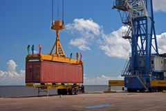 Crane container. Industrial Crane lifts a container Stock Photo