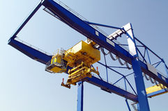 Crane in a container-port. Large industrial crane for cargo containers in port Royalty Free Stock Photography