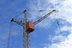 Crane. S hanging in the sky Stock Images