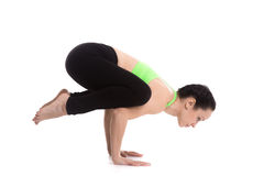 Crane (Crow) yoga Pose. Slim sporty girl doing handstand yoga asana, Crane (Crow) Pose, Bakasana for shoulders, upper back, arms and wrists Stock Photos