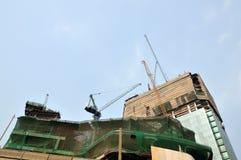 Crane on destruction building Royalty Free Stock Photo