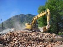 Crane dismantling building. Stock Image
