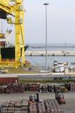 Crane on dockside loading Stock Images
