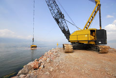 Crane dredging sea Royalty Free Stock Images