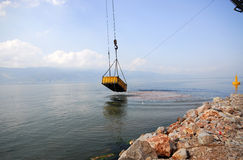 Crane dredging sea Stock Images