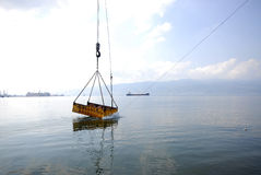 Crane dredging sea Royalty Free Stock Photography