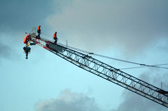 Crane driver operators check tower crane Royalty Free Stock Photography