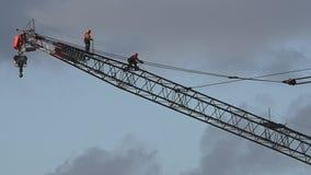 Crane driver operators walks on a tower crane stock footage