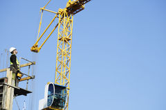 Crane driver with remote controle Stock Photography
