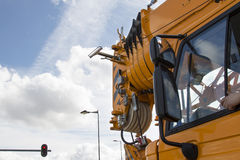 Crane driver stuck his arm out the window Royalty Free Stock Photos