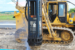 Crane driver works to set precast concrete piles for repair road Royalty Free Stock Image