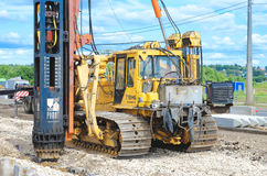 Crane driver works to set precast concrete piles for repair road Royalty Free Stock Images