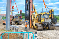 Crane driver works to set precast concrete piles for repair road Royalty Free Stock Photography