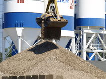 Crane dropping gravel Royalty Free Stock Photos