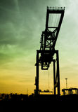 Crane at dusk. Large container crane at dusk, Antwerp harbor Stock Photo