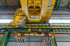 Crane with electrical magnet lift equipment Stock Photo