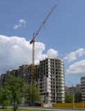 Crane on erection of residential house Royalty Free Stock Image