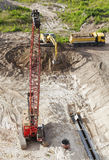 Crane, excavator and truck working on construction site. Stock Photography