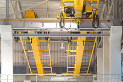 Crane. Factory overhead crane installation on rail Stock Photography