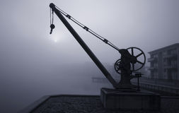 Crane a foggy morning Royalty Free Stock Image