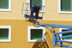 A crane in front of a building in San Juan, Puerto Rico.  royalty free stock photo