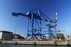 Crane in Genova port. Heavy crane in Genoa port is loading a ship, Italy Stock Image
