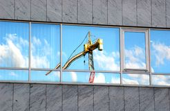 Crane in the glass. Industry reflection stock image